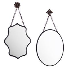 Set of 2 hanging wall mirrors with floral accents. Features 1 oval mirror and 1 with a scalloped edge.  Product: 2-piece hanging...