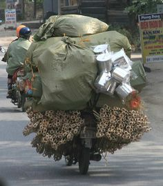 More here:  http://news.motorbiker.org/blogs.nsf/dx/50-motorcycles-carrying-anything-even-the-sink---part-1.htm