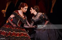 Norah Amsellem (as Violetta Valery) and Liora Grodnikaite (as Flora Bervoix) in the Royal Opera production of La Traviata at the Royal Opera House, Covent Garden, London. Composer: Giuseppe Verdi.