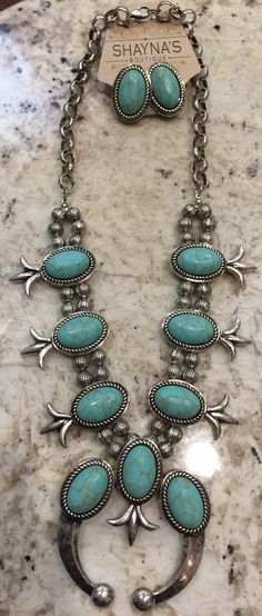 Turquoise & Silver Necklace w/Matching Earrings, this is a statement piece, can be worn with a white t-shirt and add instant style and glam! Very popular design!
