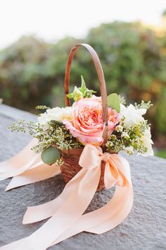 Love the peach bows decorating the sides of the basket filled with peach and white blooms ~ we ❤ this! moncheribridals.com