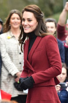 The Duchess of Cambridge opted for a maroon miniskirt and matching jacket by Paule Ka, an old favourite, in her first role as patron of Action for Children as she touched down in Wales on Wednesday morning