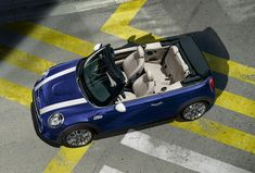 Life is a journey and not a destination with the top down on the MINI Convertible. John Cooper, Mini Cooper S, Mini Cabrio, Convertible, Car, Center Console, Camp Trunks, Elegant, Interiors