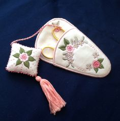The Scissor Case was completely stitched in the hoop. Scissor Fob was embroidered in two and stitched using your straight stitch sewing machine, you can also stitch the fob as a Biscornu as well if you want.