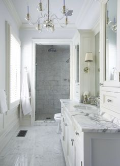upper cabinets - with mirrors. Sconces. Shower tile.