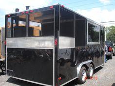 Concession BBQ Trailer, black with screened porch and BBQ Smoker. Built by M & R Specialty Trailers and Trucks in Macclenny FL.