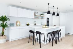 This dreamy white kitchen provides a modern, clean and minimalistic feel for your home. Kitchen by Elan Kitchens - London 55 New King's Road, London, SW6 4SE  www.elankitchens.co.uk I Love House, Fulham, Modern Kitchens, House Extensions, Minimalist, Island, London, Table, Furniture