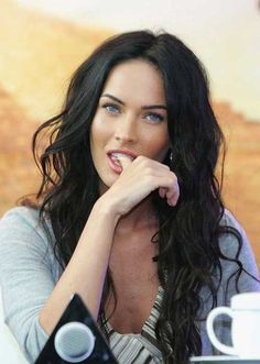 This is dead on the look of my heroine, Rebecca McCauley. Long black hair, blue eyes, fair, with chili pepper lips. :)