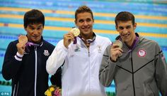 Gold Medalist South Africa's Chad le Clos (centre), Silver Medalist USA's Michael Phelps (right) and Bronze Medalist Japan's Takeshi Matsuda receive their medals after the Men's 200metre butterfly final