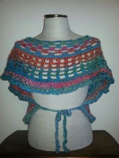 Open crochet wrap. One size fits most wool blend.  Not my desighn-free pattern from red heart called butterfly wrap.