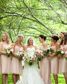 """Blushing Bridesmaids with Kate Spade bangles that read """"hand in hand"""" and """"there's strength in numbers""""."""