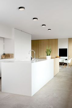 Minimal white and light wood modern kitchen