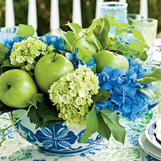 My favorite....pink hydrangeas instead of blue.... pale pink or green bowl.Love the green apples.   Punch Up the Porch | The Arrangements | SouthernLiving.com