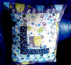 quilted cushion based on a variation of a log cabin block