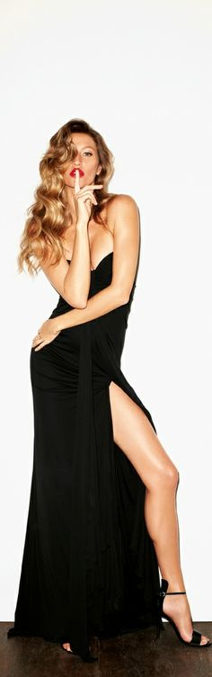 Gisele Bundchen in a long sexy black dress I love the slit up the side to show off the perfectly long legs!