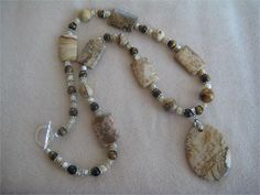 Make a statement with this chunky, southwest style beaded necklace constructed with picture jasper pillow and round beads, 6 mm brown tiger eye rounds and honey colored shell beads accented with a Bali Style, Beaded Necklace, Beaded Bracelets, Bali Fashion, Desert Landscape, Honey Colour, Southwest Style, Oval Pendant, Round Beads