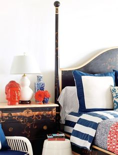 red white and blue bedding with antique wooden furniture #decor #bedroom