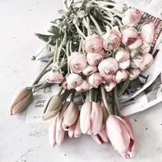 Keeping it simplistic with flowers wrapped in newspaper