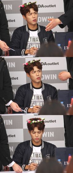 Park Bo Gum at a fansign event for Edwin - I don't know what's with the flowers on his head, but they're cute.