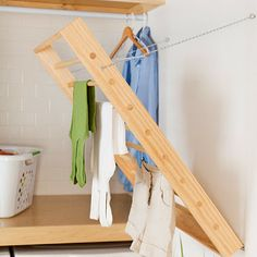 Drying rack -- if folds flat on wall when not in use and looks inexpensive to make. Love my collapsible drying rack, would love to have one built onto the wall as well.
