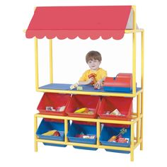 Promote your little Entrepreneur at a young age with the Pretend Play Market Stand. its brightly striped awning will invite shoppers to browse and buy. The 6 X-Size Cubbies help display today's wares Home Daycare, Dramatic Play Themes, Dramatic Play Area, Preschool Furniture, Kids Furniture, Bedroom Furniture, Tabletop, Play Market, Organization Ideas