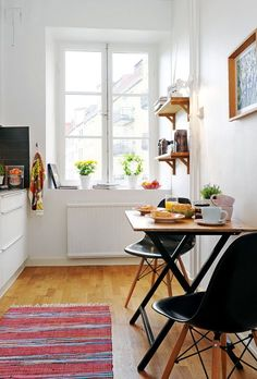Bright dining room design with white walls and wood floor