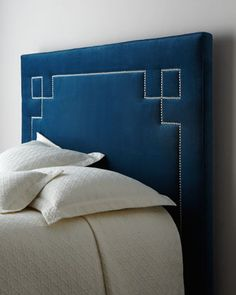 Geometric design in pewter nailhead looks fantastic on this upholstered headboard at Horchow.