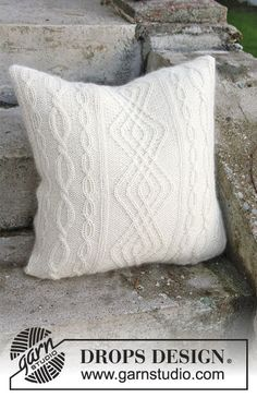 Irish Winter Pillow / DROPS Extra 0-1316 - Knitted pillow case with cables in 2 strands DROPS  Alpaca. - Free pattern by DROPS Design
