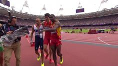 Chinese hurdler Liu Xiang limps over the finish line after injuring himself falling over a hurdle
