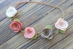 Like my facebook page and get 10% off your next order! Just message me after you like the page and i will give you the code! New style!!!  5 Medium sized roses in pretty neutral shades are accented with green leaves and attached to a tan skinny elastic headband. Perfect for photo shoots and every day wear! All of my felt creation are made with the highest quality wool blend felt and made just for you in my smoke free home. Please see my shop announcements for my current production time. Want…