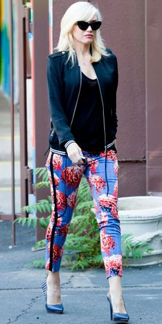 GWEN STEFANI Stefani ran errands in a tuxedo-striped floral ankle-grazing pants that she paired with a black bomber jacket and navy pumps, a...