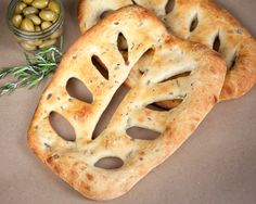 Rosemary/green olive fougasse.  Recipe looks uncomplicated and delicious, and I get to play with the magical thrifted Kitchen-Aid to mix it all up