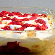 Heaven on Earth Cake made with cubes of angel food cake and layers of vanilla pudding with sour cream, cherry pie filling, whipped topping and toasted almonds
