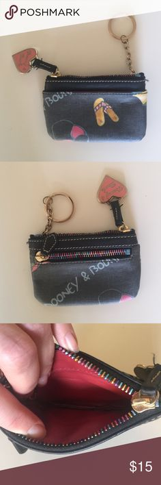Dooney & Bourke small wallet/change purse. Excellent condition change purse. Small but can fit cash and card like a regular wallet. Has key ring attached. Summer print. Rainbow zipper. Dooney & Bourke Bags