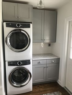 Small laundry room with Electrolux appliances, quartz counters, subway tile, and oak floors. Tiny Laundry Rooms, Mudroom Laundry Room, Laundry Room Layouts, Laundry Room Remodel, Laundry Room Bathroom, Farmhouse Laundry Room, Laundry Room Organization, Mud Rooms, Laundry Room Inspiration