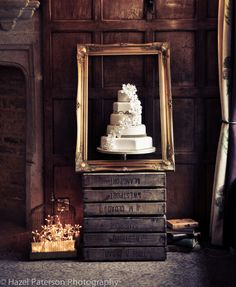 Rustic wedding cake display, gold frame with cake feature or something