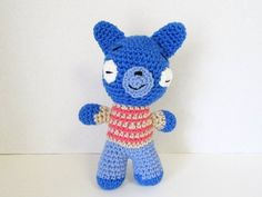 Blue fox crochet replica of Fig the Fox from Tumble Leaf. Blue fox measures 9 inches tall and about 6 inches across his body & arms. Hand-crocheted using royal blue acrylic yarn for the body and denim blue yarn for his blue jeans. Figs shirt is crocheted in orange & tan stripes