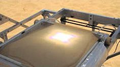 solar-powered machine transforms sand into glass object - YouTube