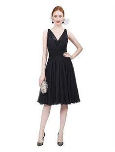 Sweet Oscar de la Renta sleeveless chiffon dress with godet skirt in black.  We love the silver clutch too.