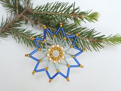 blue seed bead star, beaded Christmas tree ornament or gift tag made from beads and wire, Christmas decoration