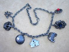 Joseff  of Hollywood Rare Charm Necklace Early and Silver Tone