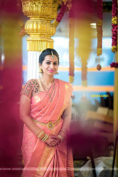 South Indian bride. Temple jewelry. Jhumkis.Pink silk kanchipuram sari.Braid with fresh jasmine flowers. Tamil bride. Telugu bride. Kannada bride. Hindu bride. Malayalee bride.Kerala bride.South Indian wedding