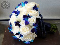 Bouquet created by Lovely Bridal Blooms  Probably more practical than the $500 one i was looking at and still beautiful!