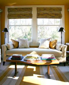 This lovely living room really emphasizes the brilliant natural light that enters the room with plenty of mustard yellow. The warm mustard colored walls and striped rug are fun and casual.
