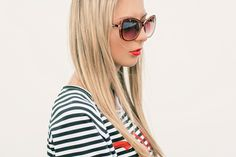 Portrait of beautiful girl with black sunglasses. Red lips.