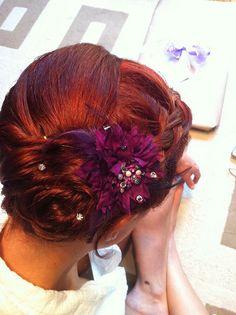 Carolyn Braden's side bun wedding hairstyle, via Flickr.
