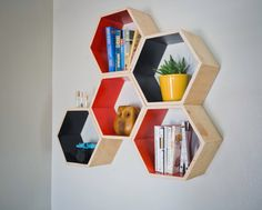 Slate Grey Floating Honeycomb Shelves. I love the shape of these. Wall art and bookshelves combined.