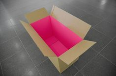 Use flourescent paper or bright paint to enliven cardboard boxes with an internal surprise. Love this for sending presents!!