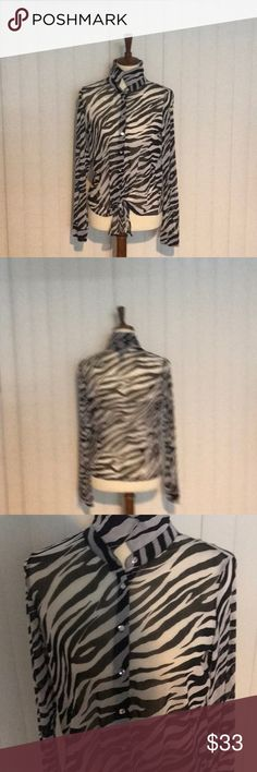 Inc black and white zebra print top. Inc black and white zebra print top. Shell 100% nylon camisole 100% Polyester. Wore a couple of time in good condition. INC International Concepts Tops Blouses
