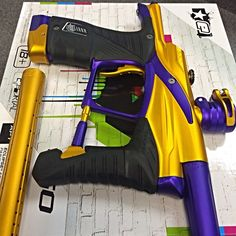 """First question I would ask, is this """"hot or not""""?! No brainer right?! Our anodize dept got creative with this beautiful combo of Gold with Purple accented Planet Eclipse LV1! We thought it would be fitting to call this color way Casino Royale! Is this for sale? Absolutely! Check it out now at ANSgear.com! #planeteclipse #planeteclipsepaintball #planetpaintball #planeteclipselv1 #planetlv1 #paintball #paintballing #paintballgun #paintballgear #ansgear"""